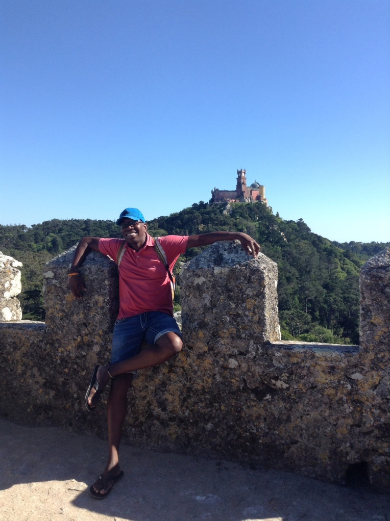 At the Moorish Castle in must-see Sintra, Portugal. In the background, the grand Pena National Palace.